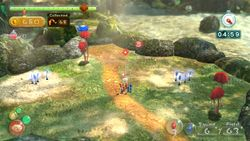 A raised plateau area in Pikmin Reunion, with Blue Pikmin sprouts on it.