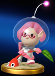 The trophy for Brittany in Super Smash Bros. for Nintendo 3DS and Wii U, showing Brittany plucking a Red Pikmin.