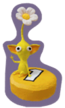 Sticker of a Yellow Pikmin sitting on a yellow Pellet.